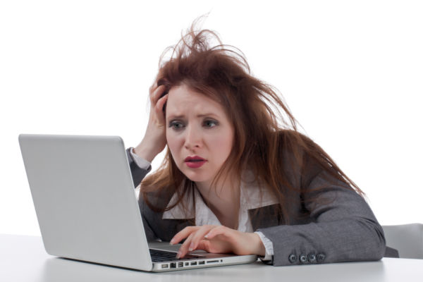 photo4design-com-23173-stressed-businesswoman-with-laptop